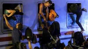 150919035853_croatia_migrants_train_640x360_afp_nocredit